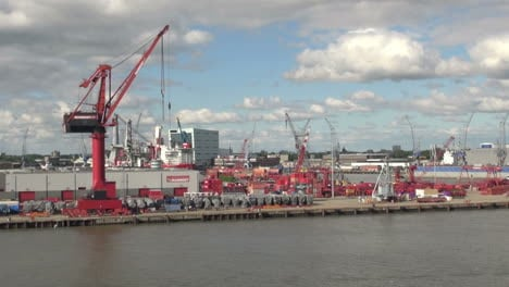 Netherlands-Rotterdam-red-crane-and-containers-on-dock