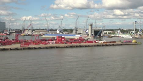 Netherlands-Rotterdam-red-containers-on-dock-and-cranes