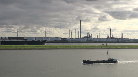 Netherlands-Rotterdam-ship-passes-refinery-stacks-14