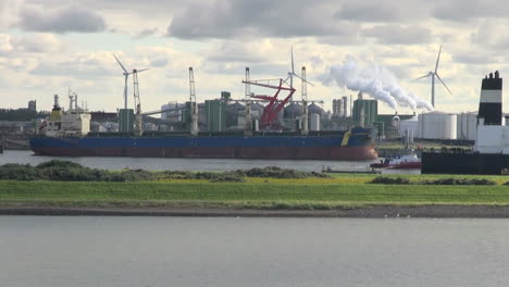 Netherlands-Rotterdam-refinery-windmills-smokestacks-and-tanker-ships