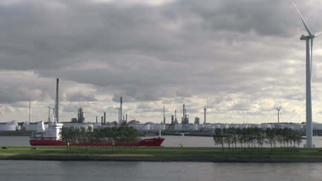 Netherlands-Rotterdam-refinery-car-passing-tanker-below-windmill-11