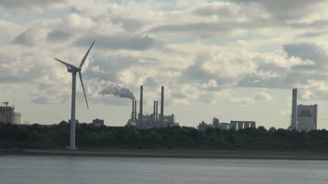 Netherlands-Rotterdam-windmill-moves-to-reveal-smokestacks-10