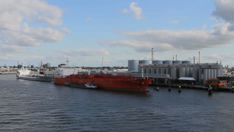 Netherlands-Rotterdam-passing-red-ship-and-refinery-2