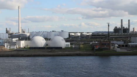 Netherlands-Rotterdam-refinery-globe-tanks-reverse-against-stack