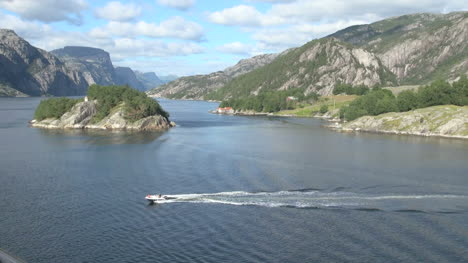 Norway-a-motorboat-in-Lysefjord-s