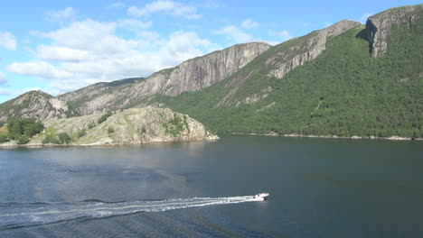 Norway-Lysefjord-a-fast-boat-leaves-a-wake-s