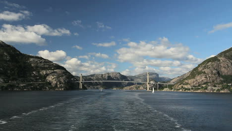 Norway-Lysefjord-wake-from-ship-with-bridge-in-distance-c