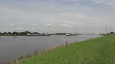 Netherlands-two-barges-move-apart-on-canal-1