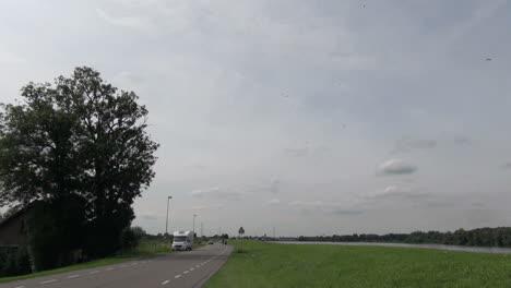 Netherlands-green-shoulder-road-and-slender-canal