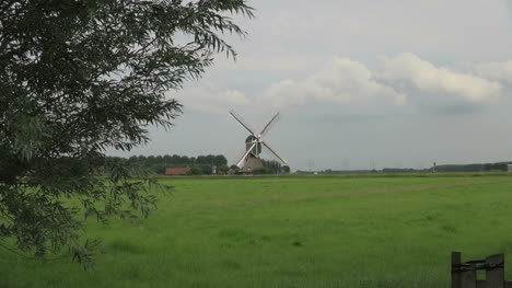 Netherlands-lush-meadow-and-x-shape-windmill-blades-3