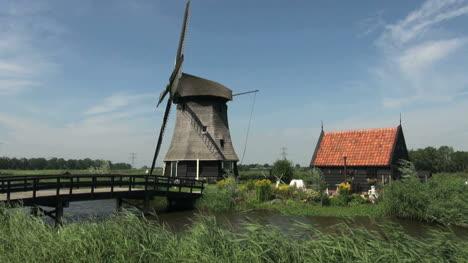 Netherlands-Kinderdijk-bridge-leading-to-windmill-and-small-windmill-19