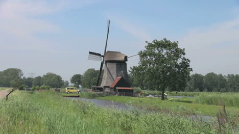 Netherlands-Kinderdijk-windmill-near-yellow-car-and-red-roof-17