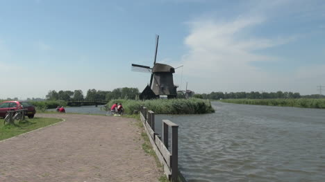 Netherlands-Kinderdijk-windmill-and-rails-by-path-zoom-15