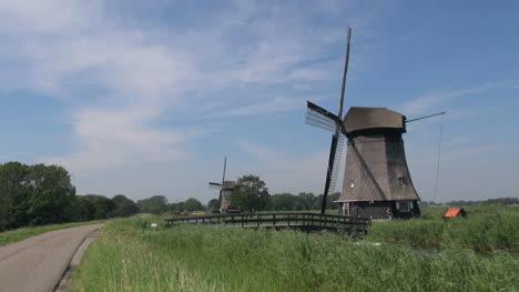 Netherlands-Kinderdijk-two-windmills-and-curved-bridge-14