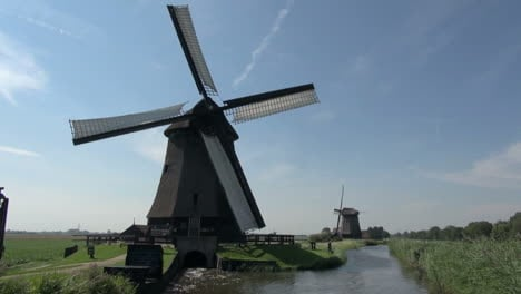 Netherlands-Kinderdijk-windmill-turning-above-outflow-into-canal-10