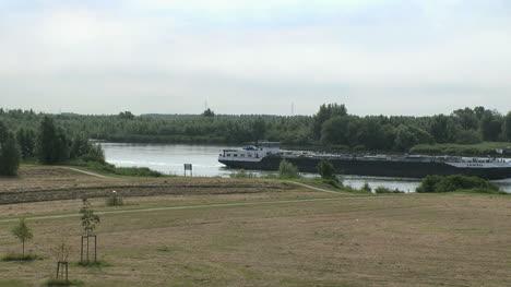 Netherlands-Oude-Maas-barge-navigates-narrow-waterway