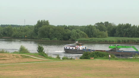 Netherlands-Oude-Maas-barge-carries-green-equipment