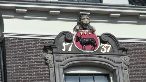 Netherlands-Edam-lion-gargoyle-and-cow-emblem