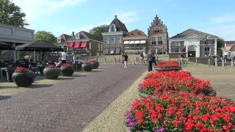 Netherlands-Edam-red-flowers-in-round-planters-on-square