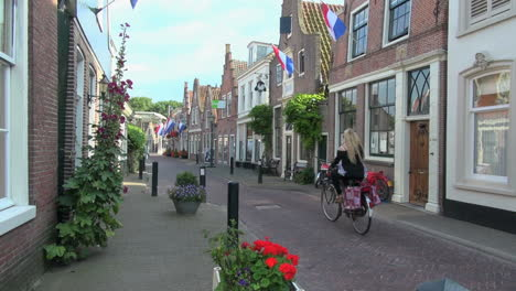 Netherlands-Edam-street-with-bike-red-flowers-and-flags