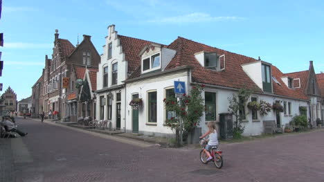 Netherlands-Edam-family-strolls-by-gable-facade