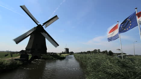 Netherlands-Kinderdijk-windmill-turning-and-flags-in-breeze-7