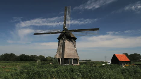Netherlands-Kinderdijk-clouds-pass-behind-windmill-blades