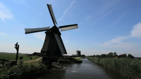 Netherlands-Kinderdijk-windmill-turning-on-side-of-canal-9