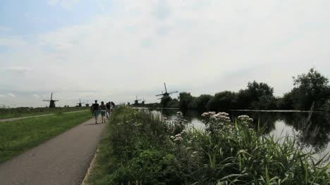 Netherlands-Kinderdijk-walking-toward-several-windmills-5