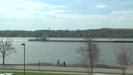 Iowa-Le-Claire-Barge-moves-on-the-Mississippi-River