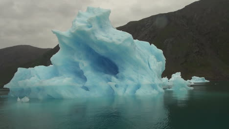 Greenland-ice-fjord-blue-berg-with-spots