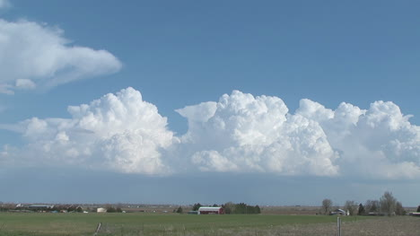 Cumulous-Clouds-move-flat-agricultural-land