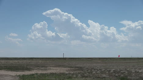 Clouds-and-a-car-on-the-plains-s1