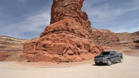 Utah-rock-on-the-road-up-Cedar-Mesa-with-truck