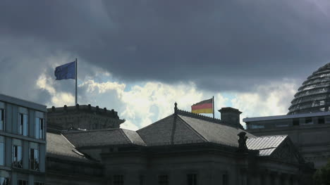 Berlin-Reichstag-backlit-dramatic-clouds-w-flags