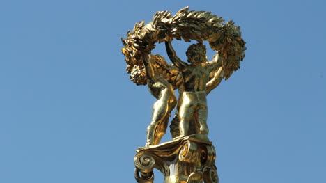 Germany-Berlin-Tiergarten-golden-cherub-sculpture-atop-monument