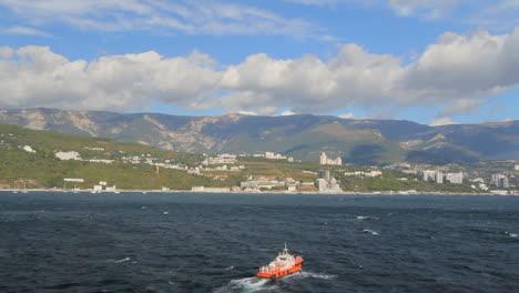Ukraine-04-Yalta-Crimean-coast-Yalta-in-distance-with-tug-boat-c-SubcCrimeanl
