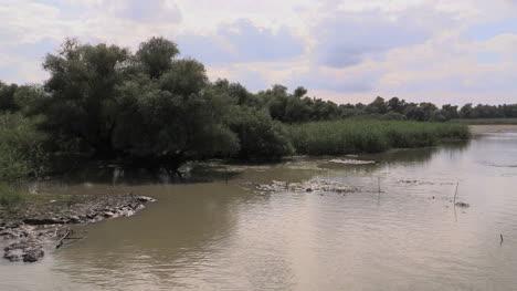 Romania-Danube-delta-passing-muddy-banks-cx