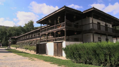 Romania-monestery-buildings-with-wood-upper-story-cx