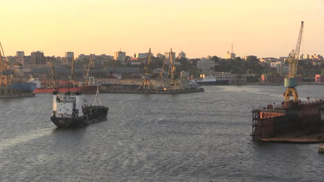 Romania-Constanta-harbour-ship-approaching-city-skyline-cx