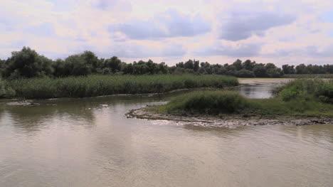 Romania-Danube-delta-passing-backwater-pond-cx
