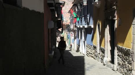 La-Paz-back-street-Tourist-walks-up-street
