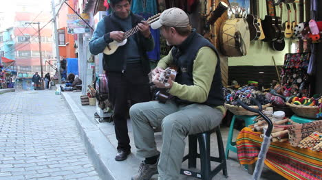 Tourist-playing-a-guitar-in-a-market