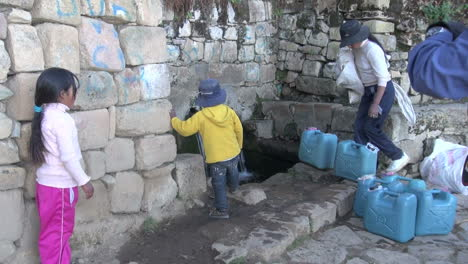 Children-at-a-fountain-on-Bolivia-Island-of-Sun-s