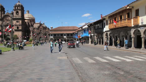 Cusco-street-by-plaza-with-traffic-c