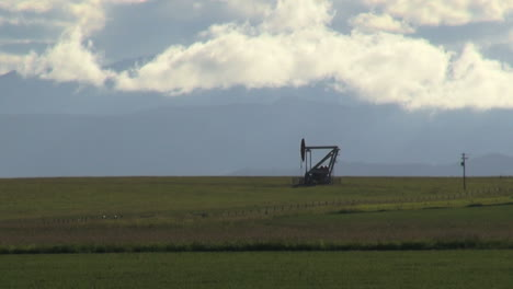 Canada-Alberta-oil-well-with-clouds-s