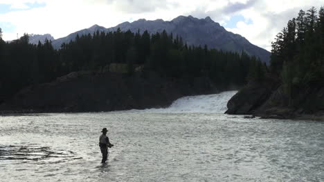 Canada-Banff-fisherman-by-waterfall-in-Bow-River-s
