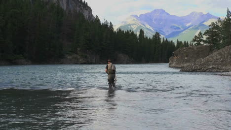 Canada-Alberta-Banff-Bow-River-fisherman-wading-and-mountain-7