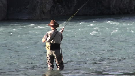 Canada-Alberta-Banff-Bow-River-fisherman-casts-into-rapids-8