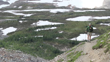 Canada-Alberta-Banff-Eiffel-Lake-Trail-hiker-and-snow-patches-12